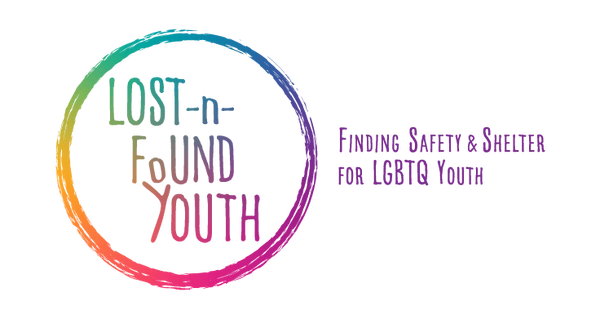 """The logo for Lost-n-Found Youth. """"Finding Safety & Shelter for LGBTQ Youth"""" is displayed next to the image. The logo features """"Lost-n-Found"""" in a rainbow gradient in a circle."""
